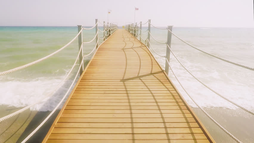 Summer beach jetty walking.Beach jetty on a ocean | Shutterstock HD Video #1014935185