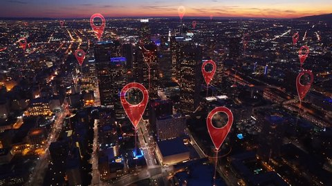 Aerial smart city. Localization icons in a connected futuristic city.   Technology concept, data communication, artificial intelligence, internet of things. Los Angeles skyline.