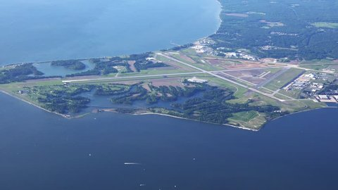 Patuxent River Naval Air Base, 4k aerial overview on a clear spring morning.