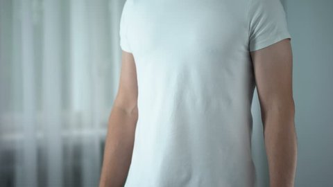 Man feeling stomach pain at home, gastritis symptom, peptic ulcer, pancreatitis