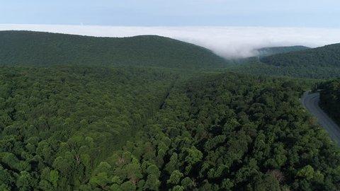 An early foggy morning aerial view of a Pennsylvania Appalachian Mountain valley.