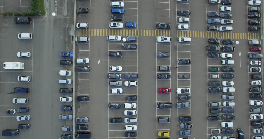 4k top aerial view of carpark with lots vacant space places traffic diagram. Flying over colorful cars moving parking shopping mall center. Transport automobile structure pattern vehicle business