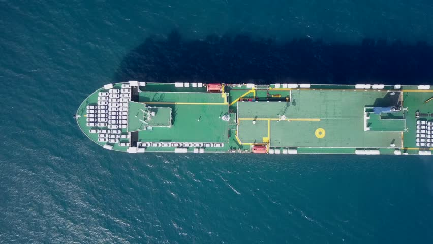 Aerial footage of a Large RoRo (Roll on/off) Vehicle carrie vessel cruising the Mediterranean sea