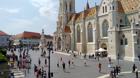 Budapest, Hungary -  5 august, 2018: tourists visiting the ancient Matthias Church and the bastions of the fishermen located in Buda built in 1269.