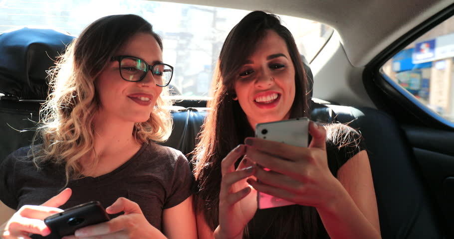 Friends posing for a selfie with cellphone #1015061035