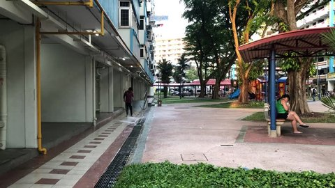 Aug 14/2018 A person is cleaning the HDB ground floor at Tiong Bahru Orchid during late afternoon, Singapore