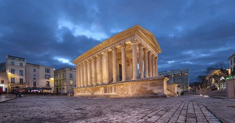 Maison Carree - restored roman temple in Nimes, France (static image with animated sky)