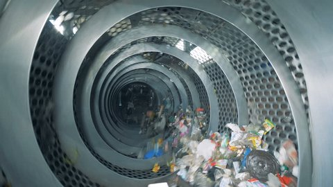 Garbage recycling machine during working process. Garbage sorting plant.