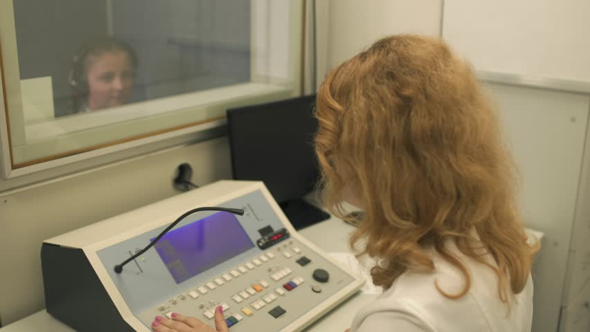 Doctor checks the hearing with equipment | Shutterstock HD Video #1015148635