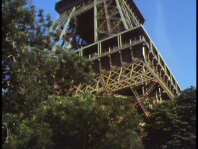 PARIS, FRANCE, 1988, The Eiffel Tower, low, tilt up, framed in trees