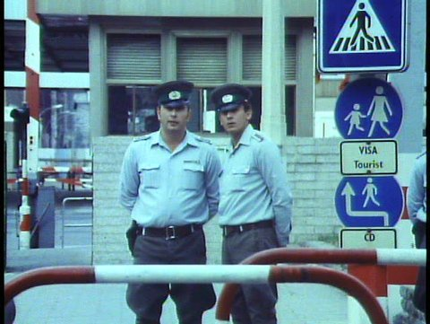 WEST BERLIN, WEST GERMANY, 1988, The Berlin Wall, two East German soldiers watch
