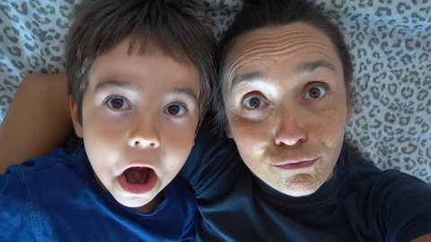 4K Selfie Mother and son clown making funny faces, crystal child