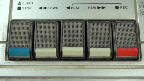 Pressing Play Button on a Vintage Tape Player