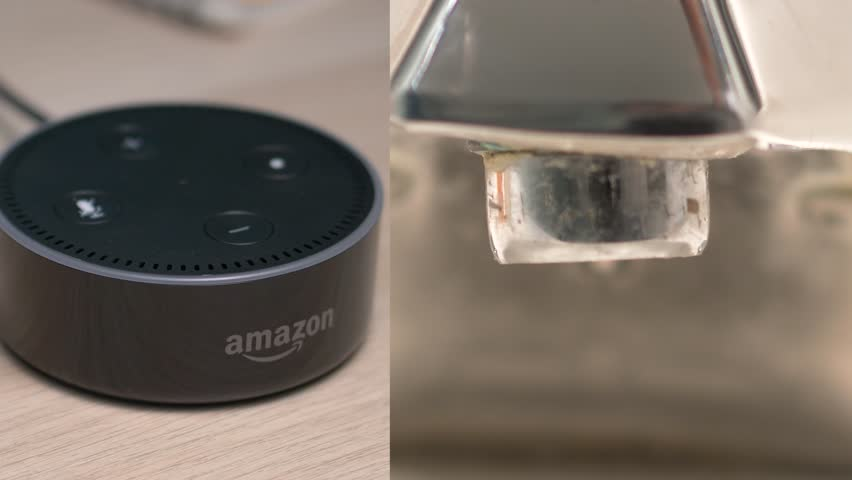 MONTREAL, CANADA - August 2018 : Smart Home intelligent assistant opening the water faucet letting water flow. Amazon Echo Alexa Dot