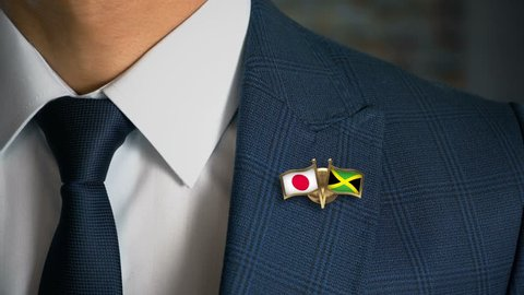 Businessman Walking Towards Camera With Friend Country Flags Pin Japan - Jamaica