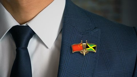 Businessman Walking Towards Camera With Friend Country Flags Pin China - Jamaica