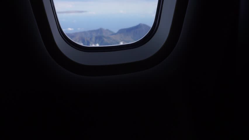 Views of the tambora mountain from behind the windows of airplanes | Wide shot | Slow motion