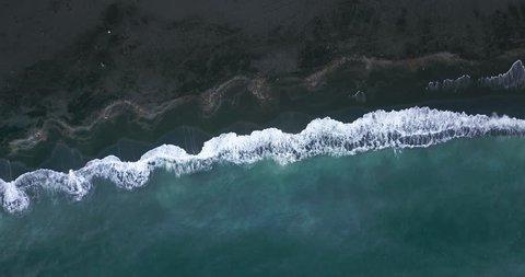 Waves crashing on a black beach in Hunaþing Vestra, Northern Iceland