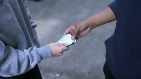 Senior student extorts money from younger boy, school bullying, robbery crime