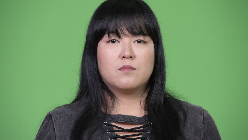 Beautiful overweight Asian woman covering mouth as three wise monkeys concept | Shutterstock HD Video #1015376245