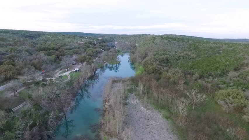 Aerial footage from a drone flying over Paradise canyon river San Antoni Texas Great place for tubing. | Shutterstock HD Video #1015388335
