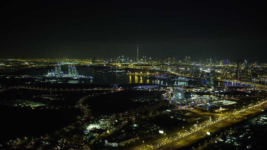 Aerial illuminated night shoreline view city skyscrapers harbor commercial Port area United Arab Emirates Middle East Dubai RED WEAPON | Shutterstock HD Video #1015415155