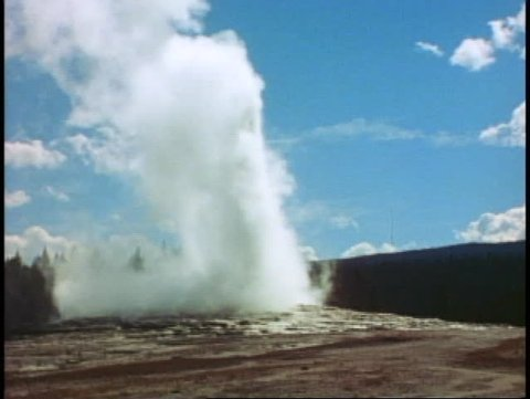 YELLOWSTONE NATIONAL PARK, WYOMING, 1978, Old Faithful Geyser, wide shot