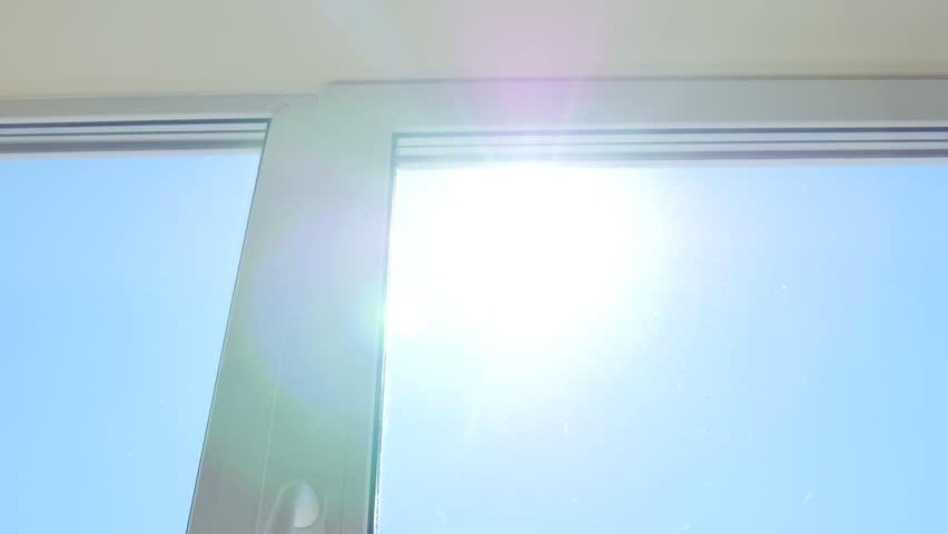 The Sun's rays shine window | Shutterstock HD Video #1015428625