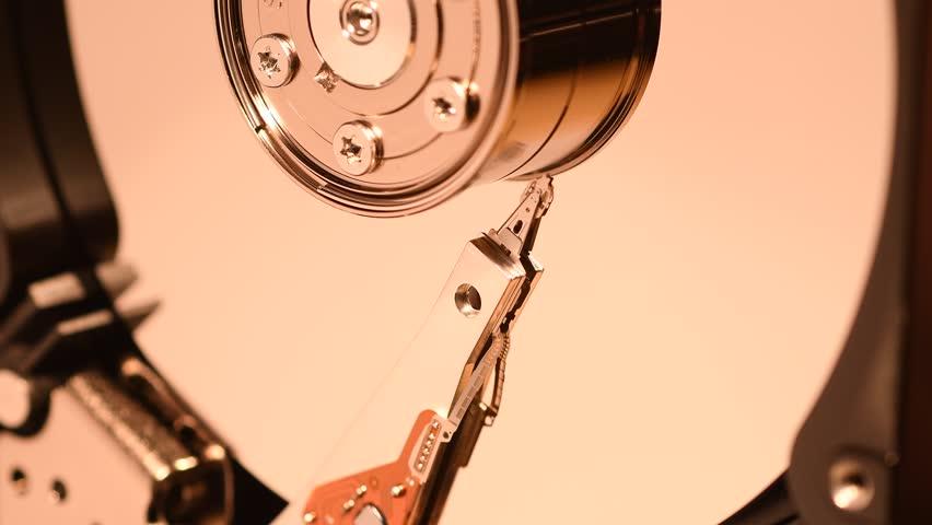 Hard Disk Drive, Close up of a hard disk drive reading and writing data. 4K UHD video. Nikon D500