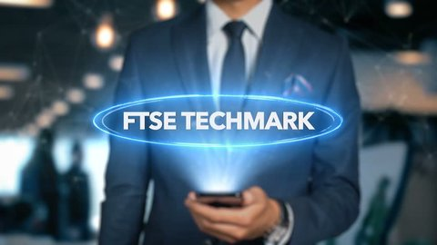 Businessman With Mobile Phone Opens Hologram HUD Interface and Touches Word - FTSE TECHMARK