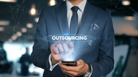 Businessman With Mobile Phone Opens Hologram HUD Interface and Touches Word - OUTSOURCING