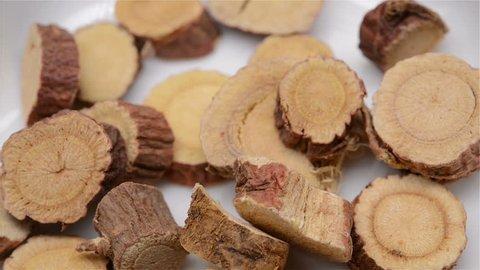 Chinese herb medicine of Glycyrrhizae Radix et Rhizoma or Liquorice Root rotating close up
