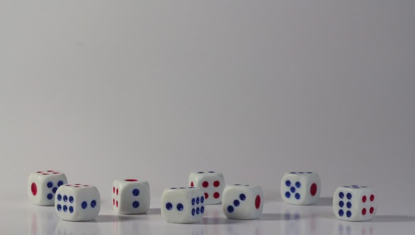 Hand playing with Dice on white background. | Shutterstock HD Video #1015581655