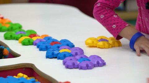 Play center for kids, children assembling toy constructor, brain training games