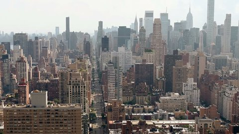 aerial over Manhattan buildings toward Empire State Building New York City NYC 1080 HD