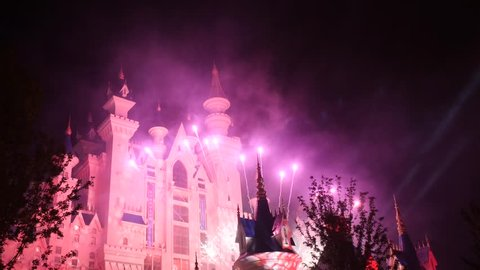 Fantasy fairytale castle with fireworks display at night. Celebration party.