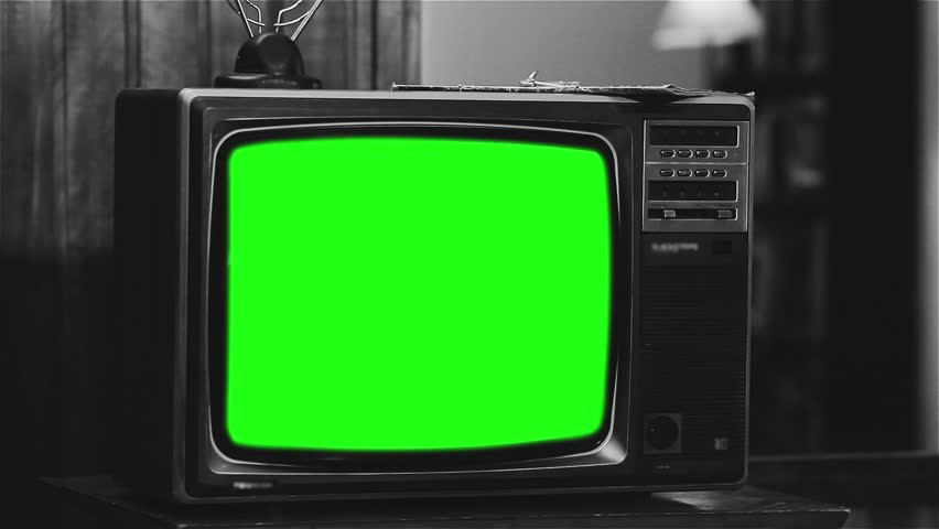 "Old 1980s TV with Green Screen. Black and White Tone. Zoom In Deep. Ready to Replace Green Screen with any Footage or Picture you Want. You Can Do It With ""Keying"" (Chroma Key) Effect.   