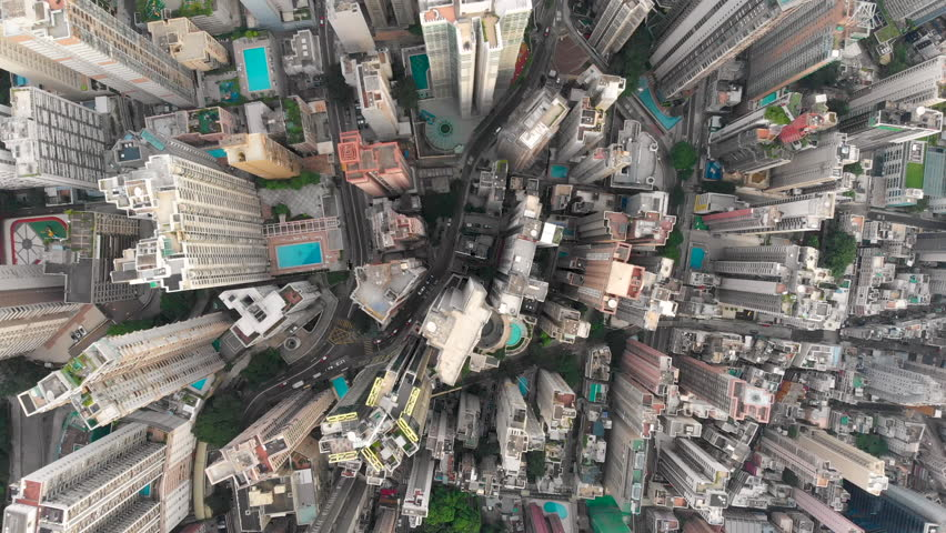 Aerial drone shot of congested building area of Hong Kong city and traffic | Shutterstock HD Video #1015702525