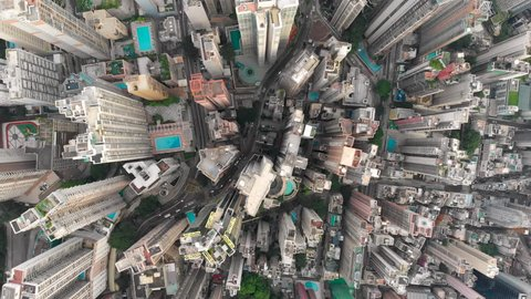 Aerial drone shot of congested building area of Hong Kong city and traffic