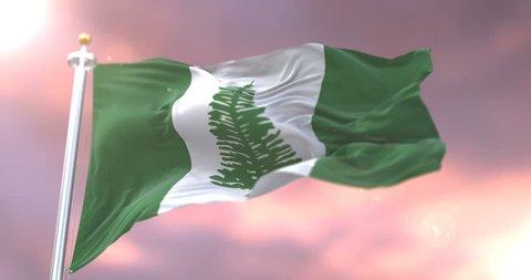 Norfolk Island flag waving at wind in slow at sunset, loop