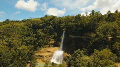 Waterfall in green rainforest. waterfall in the mountain jungle. Philippines Tropical landscape Bohol, Philippines