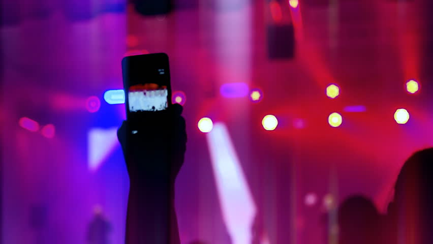 Record video on your smartphone at the concert | Shutterstock HD Video #1015844755