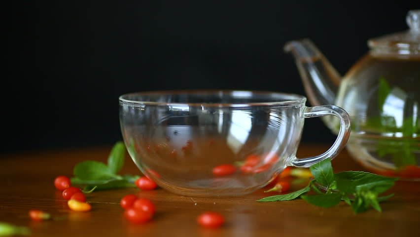 hot tea from ripe red goji berries in a glass teapot