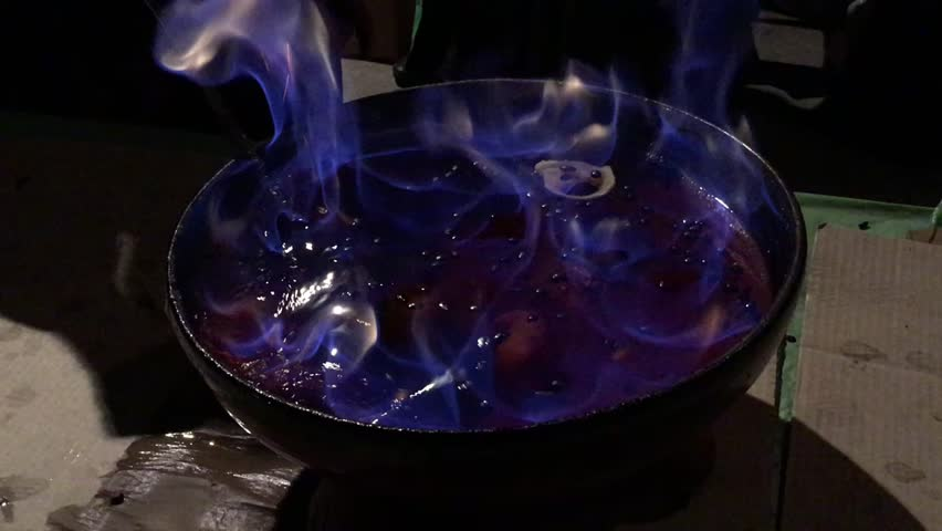 Burning alcoholic beverage with fruit in a bowl close-up | Shutterstock HD Video #1015861885