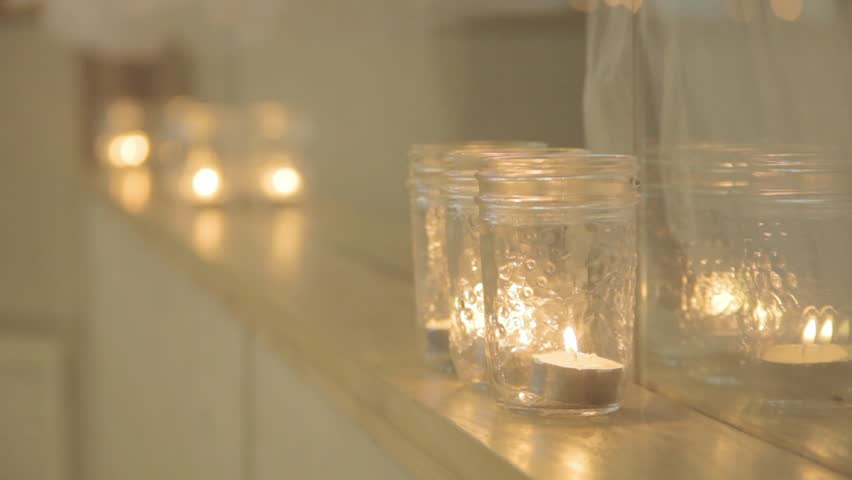 Elegant candles flickering in the background. | Shutterstock HD Video #1015882795