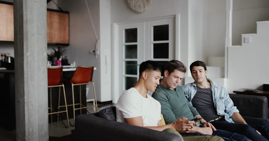 Male friends looking at smartphone together | Shutterstock HD Video #1015898125