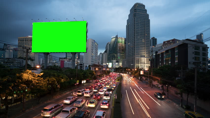 4k timelapse day to night of light trails in road to Asoke district at the center of heart business district in Bangkok city downtown Thailand