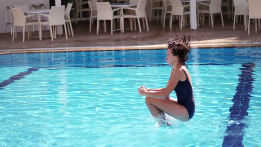 Summer Jumping In Pool Hy Woman Jump Swimming Hot Have Fun At Resort Enjoy Time Lifestyle