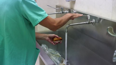 Hospital Worker Washing Hands With Iodine Before Procedure