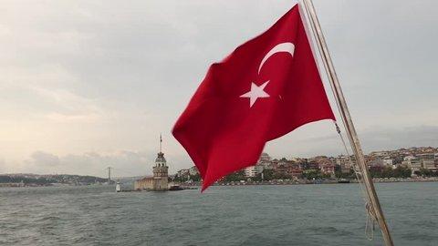 Maiden Tower view with Turkish flag & Bosporus bridges.